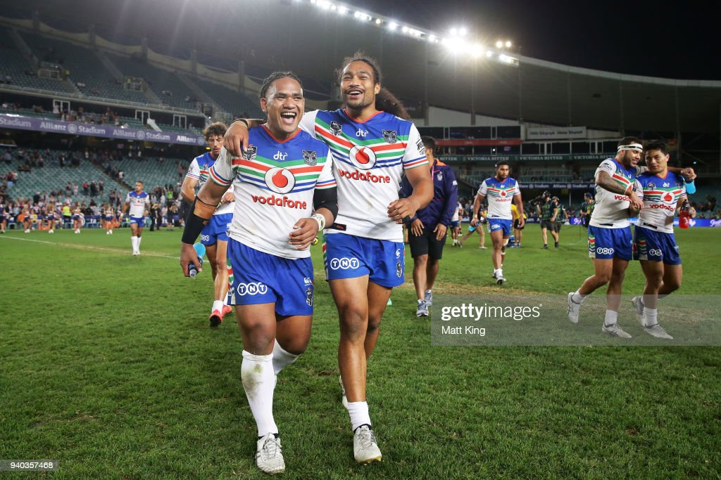 Solomone Kata (L) and Bunty Afoa (R) of the Warriors celebrate victory with team mates at the end of the round four NRL match between the Sydney Roosters and the New Zealand Warriors at Allianz Stadium on March 31, 2018 in Sydney, Australia.