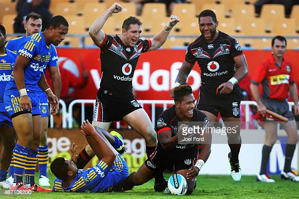 Solomone Kata of the New Zealand Warriors celebrates scoring a try with teammates Ryan Hoffman and Manu Vatuvei during the round three NRL match...