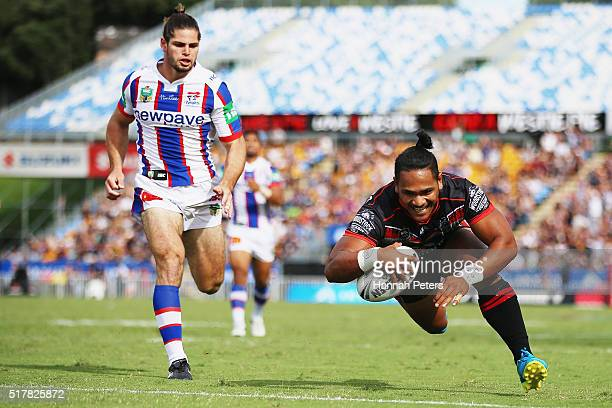Solomone Kata of the Warriors dives over to score a try during the round four NRL match between the New Zealand Warriors and the Newcastle Knights at...