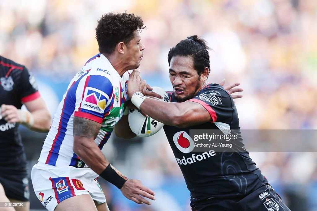 Solomone Kata of the Warriors fends against Dane Gagai of the Knights during the round one NRL match between the New Zealand Warriors and the Newcastle Knights at Mt Smart Stadium on March 5, 2017 in Auckland, New Zealand.