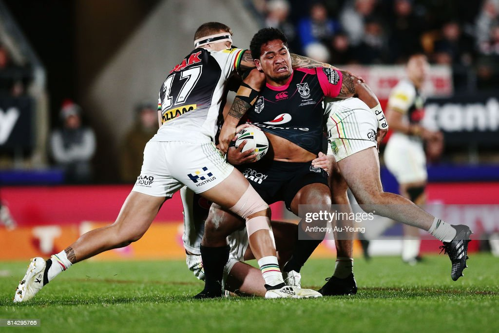Solomone Kata of the Warriors is tackled by Mitch Rein and James Fisher-Harris of the Panthers during the round 19 NRL match between the New Zealand Warriors and the Penrith Panthers at Mt Smart Stadium on July 14, 2017 in Auckland, New Zealand.