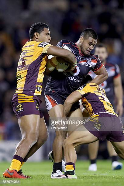 Solomone Kata of the Warriors is tackled by Tevita Pangai Junior of the Broncos during the round 13 NRL match between the New Zealand Warriors and...
