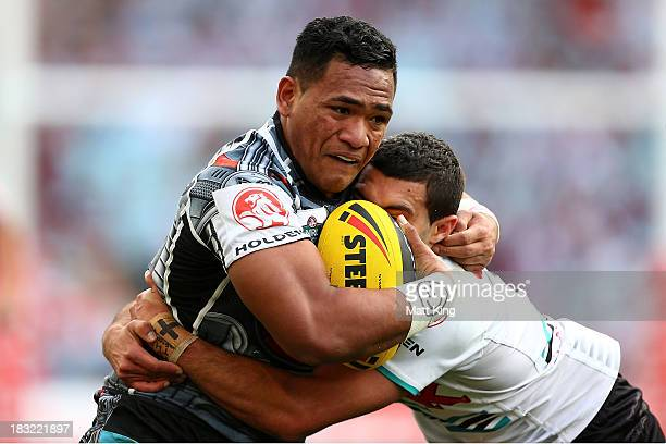 Solomone Kata of the Warriors is tackled during the 2013 Holden Cup Under 20's Grand Final match between the New Zealand Warriors and the Penrith...