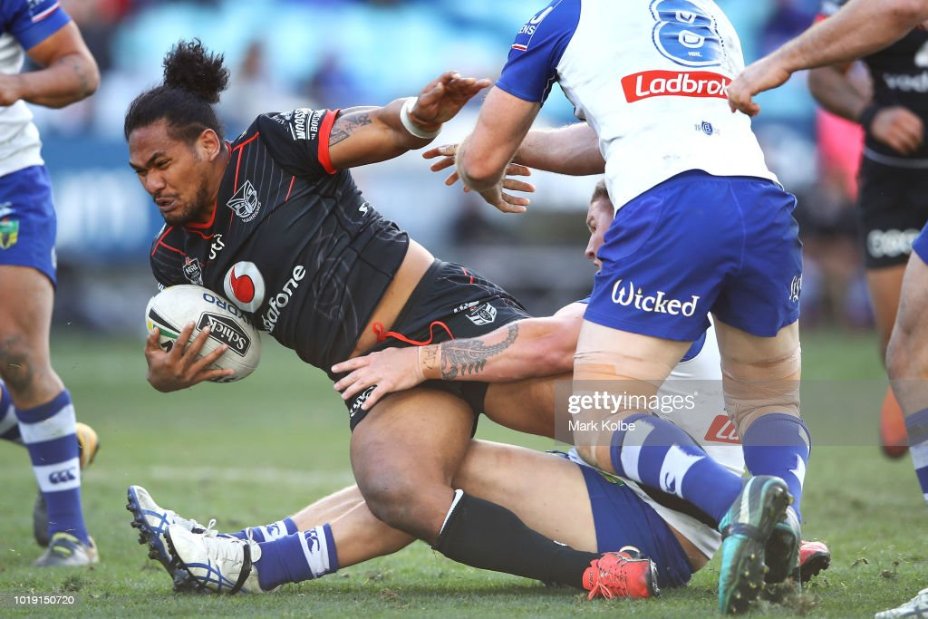 Solomone Kata of the Warriors is tackled during the round 23 NRL match between the Canterbury Bulldogs and the New Zealand Warriors at ANZ Stadium on August 19, 2018 in Sydney, Australia.