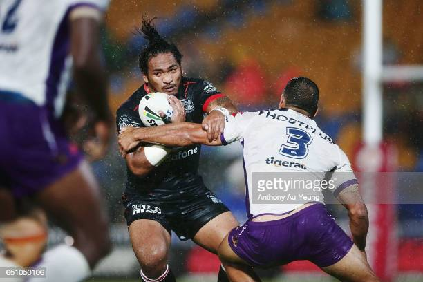 Solomone Kata of the Warriors makes a run at Will Chambers of the Storm during the round two NRL match between the New Zealand Warriors and the...