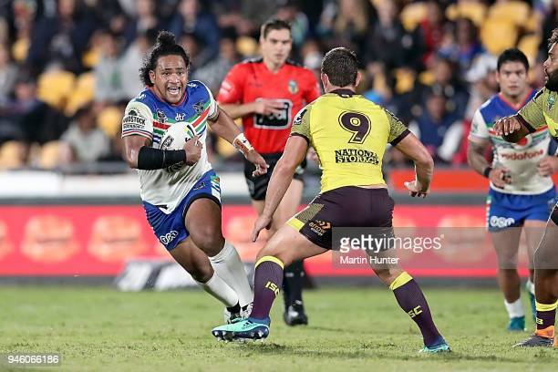 Solomone Kata of the Warriors runs the ball at Andrew McCullough of the Broncos during the round six NRL match between the New Zealand Warriors and...