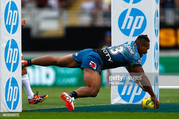 Solomone Kata of the Warriors scores a try during the match between the Warriors and the Titans in the 2015 Auckland Nines at Eden Park on January...