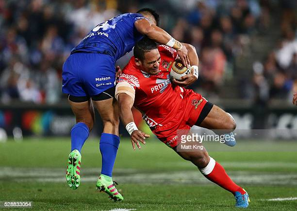 Solomone Kata of Tonga is tackled during the International Rugby League Test match between Tonga and Samoa at Pirtek Stadium on May 7 2016 in Sydney...