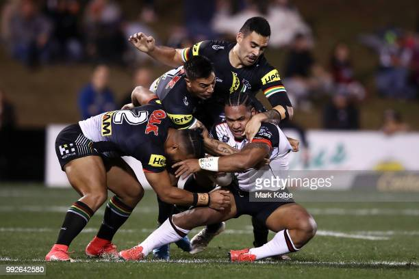 Solomone Kata of Warriors is tackled during the round 17 NRL match between the Penrith Panthers and the New Zealand Warriors at Panthers Stadium on...