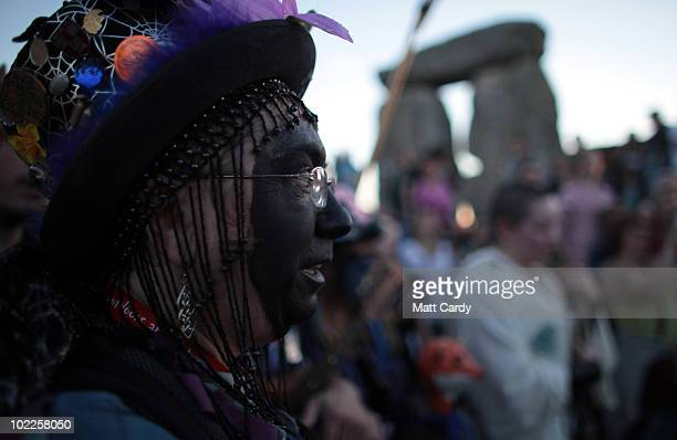 A solstice participant takes part in a Solstice sunset service as people gather in the megalithic monument of Stonehenge on June 20 2010 on the edge...