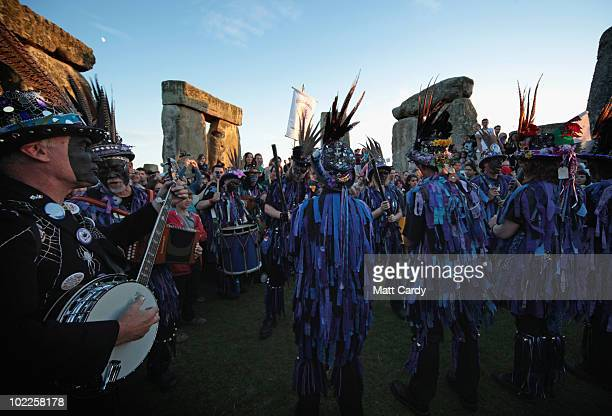 Solstice participants conduct a Solstice sunset service as people gather in the megalithic monument of Stonehenge on June 20 2010 on the edge of...