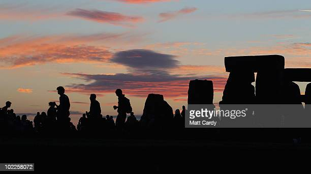 Solstice participants wait for the midsummer sun to rise over the megalithic monument of Stonehenge on June 20 2010 on the edge of Salisbury Plain...