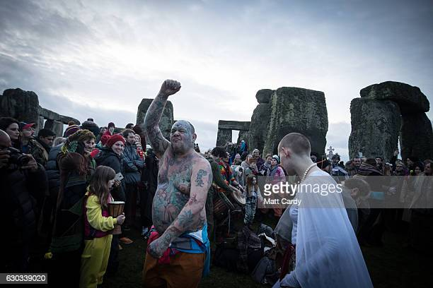 Solstice reveller Mad Al dances as druids pagans and revellers gather in the centre of Stonehenge hoping to see the sun rise as they take part in a...