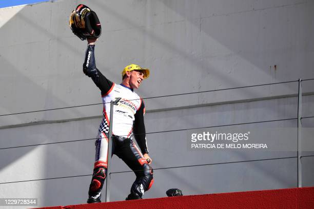 Solunion Aspar Team's Spanish rider Albert Arenas celebrates on the podium after becoming the new Moto3 world champon following the Moto3 race of the...