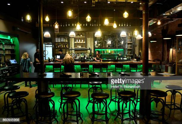 DENVER CO OCTOBER 10 Solutions Lounge bartender Rachel Dunning behind bar chats with owner Tina Ronder far left and customer Paige Tibbetts at the...