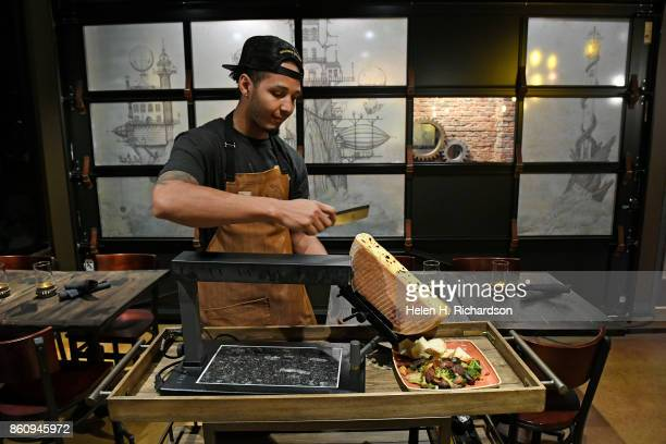 DENVER CO OCTOBER 10 Solutions Lounge Executive chef Darian Blackwell gets ready to serve vegetarian raclette table side on October 10 2017 in Denver...