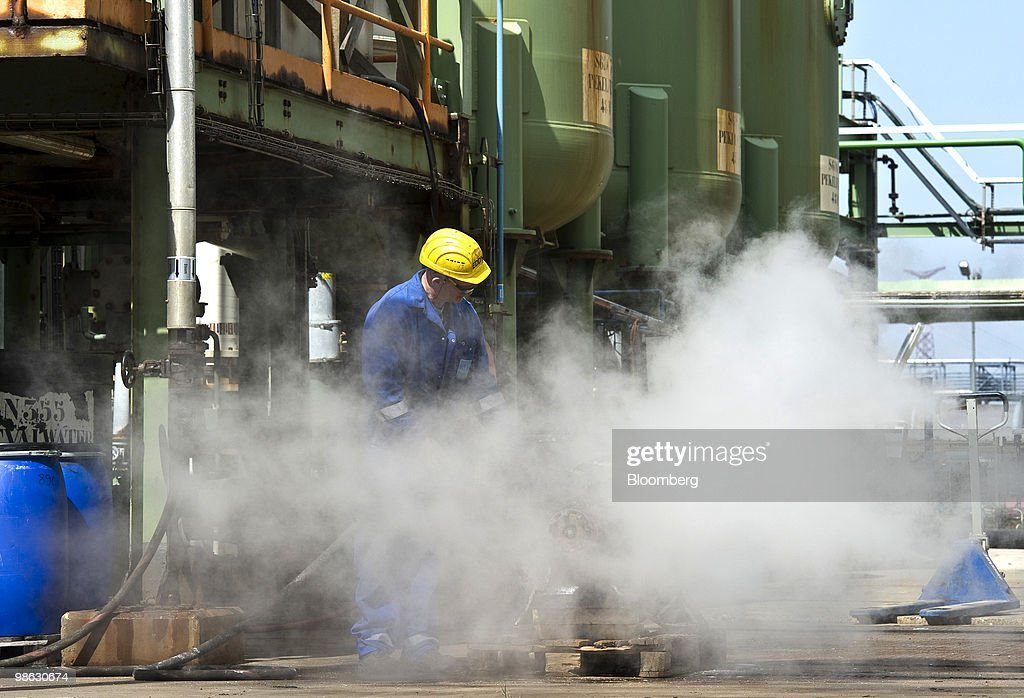 A Solvay SA employee carries out routine maintenance at the company's chemical plant in Antwerp, Belgium, on Thursday, April 22, 2010. Confidence within Europe�s chemical industry has risen for the first time in 21 months, ICIS news reported, citing data from the European Chemical Industry Council. Photographer: Jock Fistick/Bloomberg via Getty Images