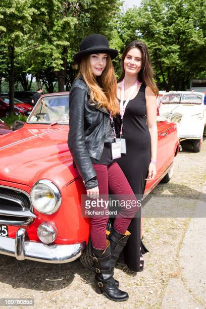 Solveig Lizlow and Lara Micheli pose with a Peugeot 403 as they take part to the 14th Edition of the 'Rallye des Princesses' at Esplanade Des...