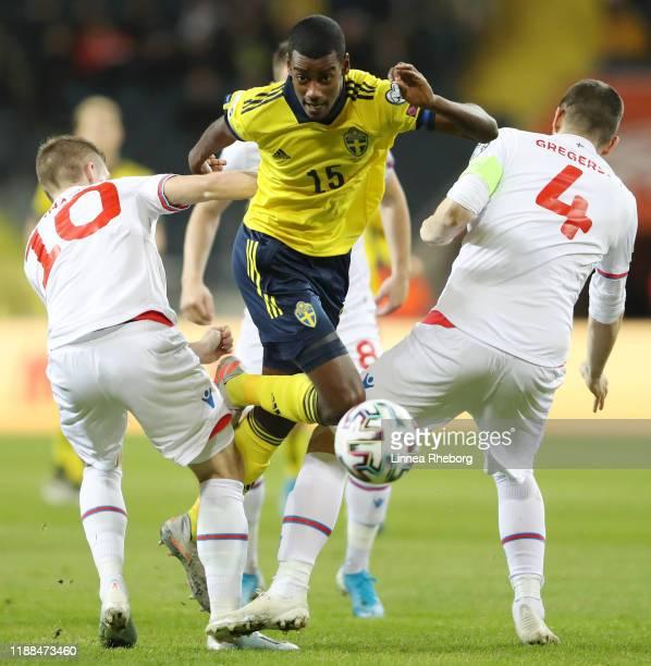 Solvi Vatnhamar of Faroe Islands and Atli Gregersen of Faroe Islands collide with Alexander Isak of Sweden during the UEFA Euro 2020 Qualifier...