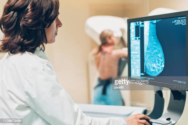 solving women's health issues - mammogram stock pictures, royalty-free photos & images