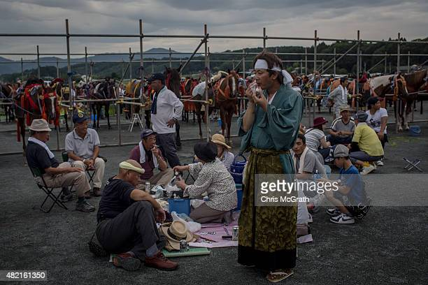 Soma Nomaoi festival participants enjoy a meal at the Ohta Shrine while waiting for the parade to start ahead of the days racing on July 25 2015 in...