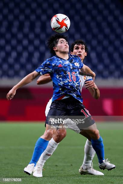 Soma Yuki of Japan competes for the ball with Jesus Vallejo of Spain during the Olympic football semifinal between Japan and Spain at Saitama Stadium...