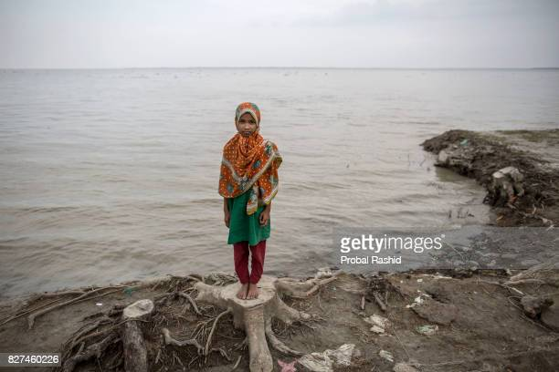 BHOLA BARISAL BANGLADESH BHOLA BARISAL BANGLADESH Somaia poses for a portrait stands on the bank of river Meghna where her home lost due to erosion...