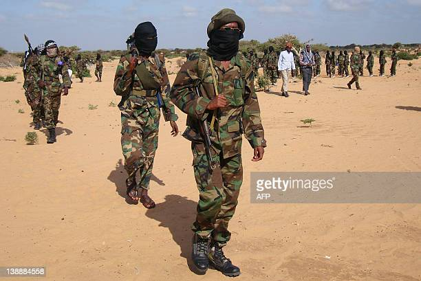 Somali Al-Shebab fighters gather on February 13, 2012 in Elasha Biyaha, in the Afgoei Corridor, after a demonstration to support the merger of...