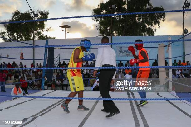 Somali boxer Kashmir Abdirahim Abdalla 18yearsold fights during a match in a ring installed at Wish Stadium in Mogadishu on November 15 2018 Somalia...