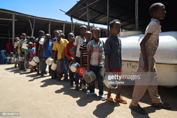 Somali boys wait in line at a World Food program 'wet food' distribution center in central Mogadishu Hundreds of new arrivals mostly from the hardest...