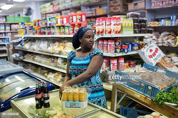 Somali business owner stocks her store during a visit by Emily Cain Democratic candidate for Maine's 2nd Congressional District in Lewiston Maine...