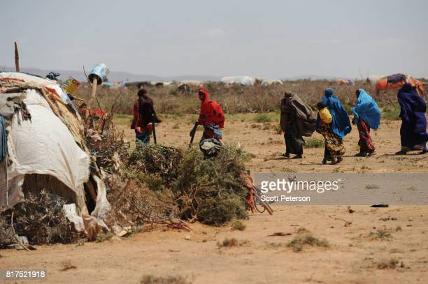 Somali families displaced by severe drought create a makeshift camp as the Horn of Africa faces severe drought on the outskirts of the village of War...