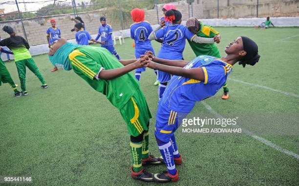 Somali football players of Golden Girls Football Centre Somalia's first female soccer club attend their training session at Toyo stadium in Mogadishu...