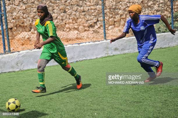 Somali football players of Golden Girls Football Centre, Somalia's first female soccer club, attend their training session at Toyo stadium in...