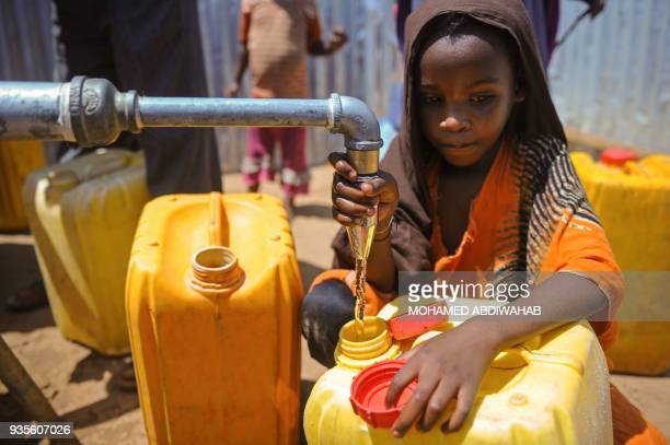 Somali girl collects water from a well at the Tawakal IDP camp on the outskirts of Mogadishu Somalia on March 2018 World Water Day on March 22 calls...