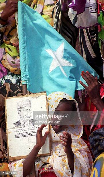 Somali girl sings a song 23 December 1993 at a rally for Somali warlord Mohamed Farah Aidid Another 500 US troops are preparing to leave Mogadishu...