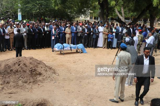 Somali government officials including Prime minister perform the Janaza prayers on August 4, 2019 in Mogadishu during the funeral ceremony of late...
