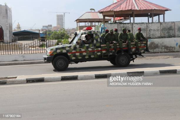 Somali government soldiers on a Military vehicle are seen outside the SYL hotel in Mogadishu on December 11, 2019. - An attack by members of the...