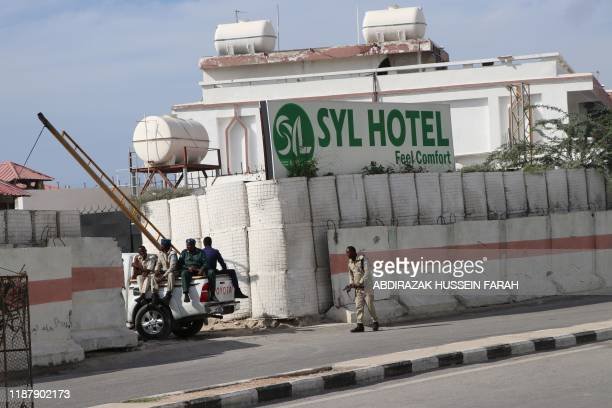 Somali government soldiers seen at the entrance of the SYL hotel in Mogadishu on December 11, 2019. - An attack by members of the radical Islamic...