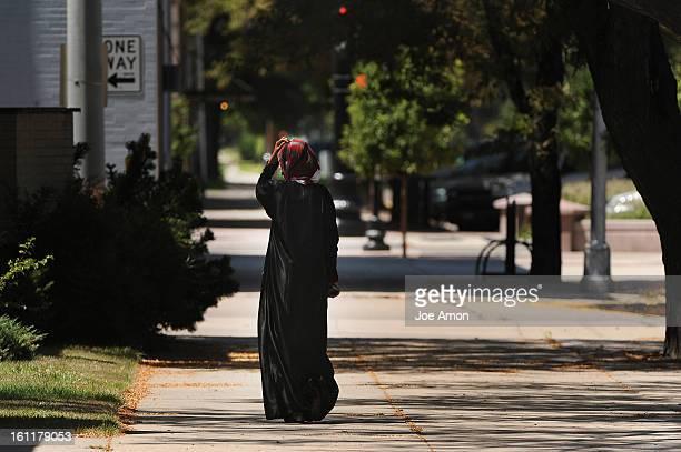 A Somali immigrant walks along Kiowa Street in Fort Morgan Joe Amon The Denver Post