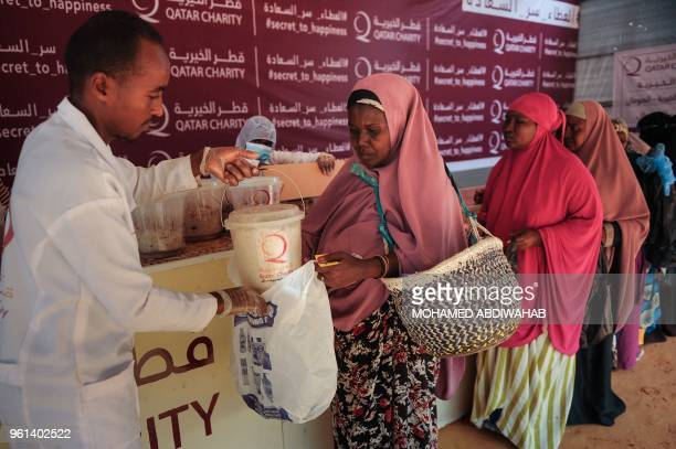 Somali internally displaced people receive food distribution in Mogadishu Somalia on May 22 2018 About 800 internally displaced people from 8 camps...