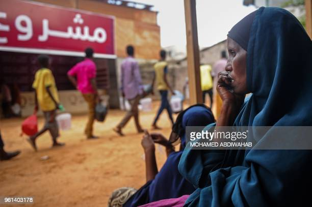 Somali internally displaced people wait to receive food distribution in Mogadishu Somalia on May 22 2018 About 800 internally displaced people from 8...