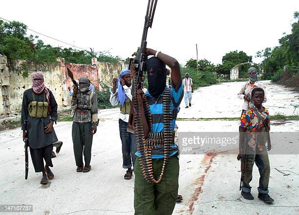 Somali Islamist insurgents patrol a street in the Tarbunka area of Mogadishu on June 17 2009 during the second day of clashes between government...