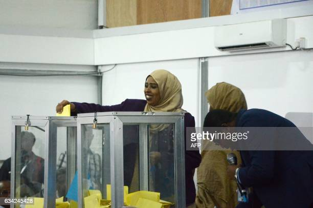 A Somali lawmaker casts her vote to elect a new president inside Mogadishu airport on February 8 2017 Somali lawmakers were choosing a president...