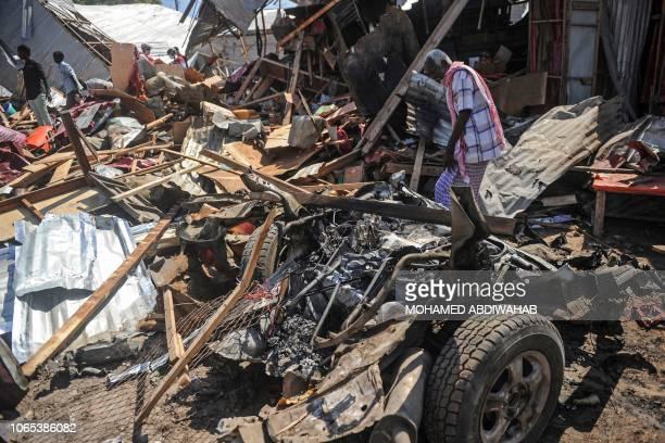 A Somali man walks among the debris after a car bomb detonated at a busy market in the capital Mogadishu Somalia on November 26 2018 The explosion...