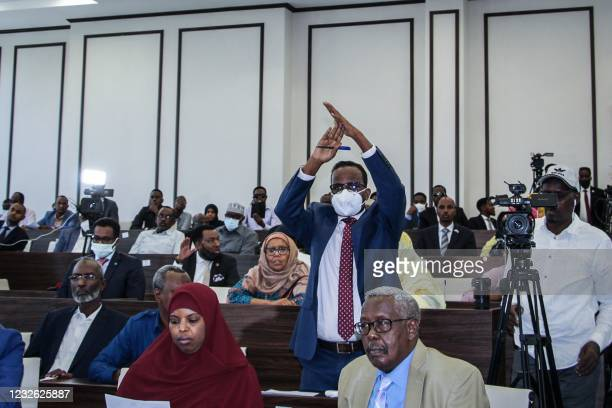 Somali member of Parliament gestures as he attends a special assembly where the president is requesting for the abandonment of the two-year extension...