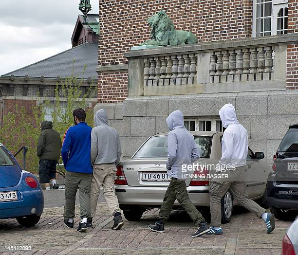 Somali men leave the court in Aarhus on May 29 2012 Two brothers of Somali origin who were arrested on May 28 suspected of plotting a terror attack...