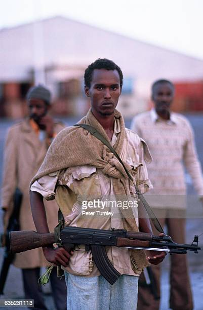 A Somali militaman part of a factional militia group fighting in the civil war carries a firearm left over from the cold war Somalia had been a...
