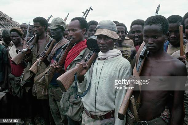 Somali militamen, part of a factional group fighting during the civil war, stand in line at the village of Hawaye, near Baidoa. In the 1980s civil...