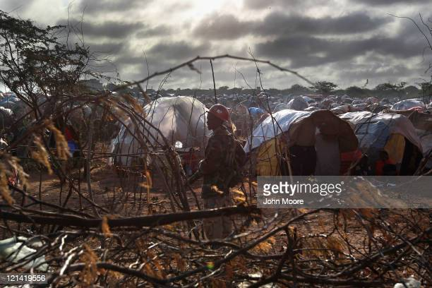Somali military policeman stands guard as Turkish Prime Minister Recep Tayyip Erdogan visits a Turkish field hospital at a camp for people displaced...